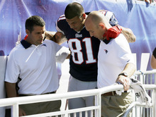 New England Patriots tight end Aaron Hernandez is helped from the field in the first quarter of an NFL football game against the Arizona Cardinals, Sunday, Sept. 16, 2012, in Foxborough, Mass. (AP Photo/Elise Amendola)