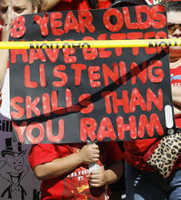 A young boy holds up a sign critical of Chicago mayor Rahm Emanuel during a rally of striking Chicago school teachers Saturday, Sept. 15, 2012, in Chicago. Union president Karen Lewis reminded the crowd that although there is a