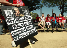 A protester holds a sign critical of Chicago mayor Rahm Emanuel during a rally of striking Chicago school teachers Saturday, Sept. 15, 2012, in Chicago. Union president Karen Lewis reminded the crowd that although there is a