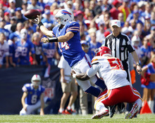 Buffalo Bills' Ryan Fitzpatrick (14) throws under pressure from Kansas City Chiefs' Justin Houston (50) during the first quarter of an NFL football game in Orchard Park, N.Y., Sunday, Sept. 16, 2012. (AP Photo/Bill Wippert)