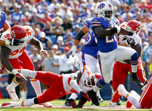 Buffalo Bills' C.J. Spiller (28) runs against the Kansas City Chiefs during the first half of an NFL football game in Orchard Park, N.Y., Sunday, Sept. 16, 2012. (AP Photo/Bill Wippert)