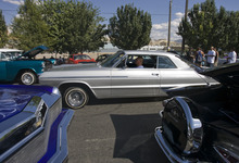 Kim Raff | The Salt Lake Tribune Como Te Gusta car club member Benny Urcino drives his 1964 Chevrolet SS Impala into the low rider car show at the El Grito de la Independencia, Mexico's official independence day, celebration and car show at Centro Civico Mexicano in Salt Lake City, Utah on September 16, 2012.