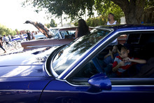 Kim Raff | The Salt Lake Tribune (right) Carlos Herrera Jr. sits with his siter Marivel Herrera in their father 81 Buick Regal during theEl Grito de la Independencia, Mexico's official independence day, festival and low rider car show at Centro Civico Mexicano in Salt Lake City, Utah on September 16, 2012.