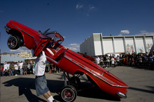 Kim Raff |  The Salt Lake Tribune Gary Smith hops his 1961 Chevrolet Impala 82 inches in the air during the El Grito de la Independencia, Mexico's official independence day, festval and low-rider car show at Centro Civico Mexicano in Salt Lake City, Utah on September 16, 2012.
