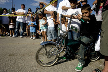 Kim Raff | The Salt Lake Tribune Felix Gallegos sits on a customized BMX bike at El Grito de la Independencia celebration, Mexico's official independence day,  at Centro Civico Mexicano low rider car show in Salt Lake City, Utah on September 16, 2012.