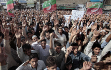 Supporters of a Pakistani Tehreek-e-Insaf or Movement for Justice chant slogans during a demonstration in Peshawar, Pakistan on Sunday, Sept. 16, 2012, as part of widespread anger across the Muslim world about a film ridiculing Islam's Prophet Muhammad. (AP Photo/Muhammad Sajjad)