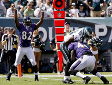 Baltimore Ravens fullback Vonta Leach (44) scores a touchdown against Philadelphia Eagles cornerback Dominique Rodgers-Cromartie (23) as Ravens wide receiver Torrey Smith (82) celebrates in the first half of an NFL football game, Sunday, Sept. 16, 2012, in Philadelphia. (AP Photo/Mel Evans)