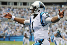 Carolina Panthers quarterback Cam Newton (1) celebrates a teammate's touchdown during the third quarter of an NFL football game against the New Orleans Saints in Charlotte, N.C., Sunday, Sept. 16, 2012. (AP Photo/Rainier Ehrhardt)