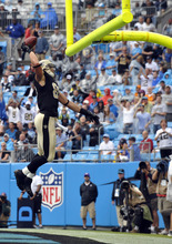 New Orleans Saints' Jimmy Graham (80) reacts after catching a touchdown pass against the Carolina Panthers during the first quarter of an NFL football game in Charlotte, N.C., Sunday, Sept. 16, 2012. (AP Photo/Rainier Ehrhardt)