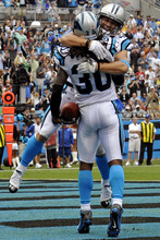 Carolina Panthers' Charles Godfrey (30) is congratulated by Haruki Nakamura after his interception return for a touchdown against the New Orleans Saints during the first quarter of an NFL football game in Charlotte, N.C., Sunday, Sept. 16, 2012. (AP Photo/Rainier Ehrhardt)