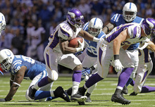 Minnesota Vikings' Adrian Peterson (28) runs during the first half of an NFL football game against the Indianapolis Colts in Indianapolis, Sunday, Sept. 16, 2012. (AP Photo/Michael Conroy)