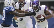 Minnesota Vikings' Percy Harvin runs against Indianapolis Colts' Antoine Bethea during the first half of an NFL football game in Indianapolis, Sunday, Sept. 16, 2012. (AP Photo/AJ Mast)