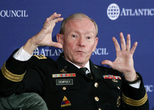 FILE - In this Dec. 9, 2011, file photo, Joint Chiefs Chairman Army Gen. Martin Dempsey speaks at the Atlantic Council in Washington. Dempsey says the problem of rogue Afghan soldiers and police turning their guns on American and allied troops is a