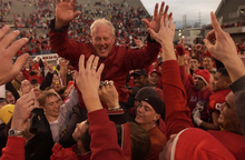 Trent Nelson | The Salt Lake Tribune  Utah head football coach Ron McBride celebrates after beating BYU 13-6 in 2002 at Rice-Eccles Stadium.