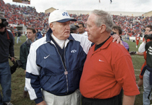 Photo courtesy of University of Utah Athletics  Utah head coach Ron McBride and BYU head coach LaVell Edwards meet at mid-field after BYU beat Utah 26-24 in 1998.