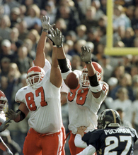 Photo courtesy of University of Utah Athletics  Utah's Richard Seals (87) and Ma'ake Kemoeatu (98) block a field goal attempt by Owen Pochman during their game in 1999. Utah went on to win the game 20-17.