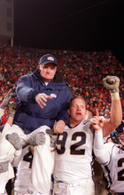 Trent Nelson | The Salt Lake Tribune  BYU coach LaVell Edwards is held aloft by his team, including #92 defensive end Ryan Denney, after a last-minute victory over Utah to end Edwards' career on Nov. 24, 2000.