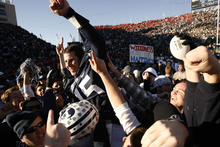 Trent Nelson | The Salt Lake Tribune BYU fans hold Brigham Young quarterback Max Hall (15) on their shoulders, celebrating victory as BYU defeats the University of Utah 17-10 at BYU's LaVell Edward Stadium on Nov. 24, 2007.