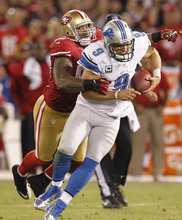 Tony Avelar | The Associated Press San Francisco's Ahmad Brooks, left, tackles Detroit quarterback Matthew Stafford during the fourth quarter.