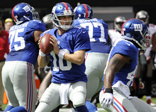 Bill Kostroun | The Associated Press Giants quarterback Eli Manning threw for 510 yards in rallying his team past the Buccaneers.