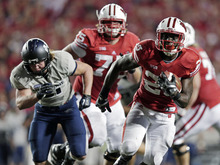 Wisconsin running back Montee Ball breaks away for a 17-yard touchdown run during the second half of an NCAA college football game against Utah State on Saturday, Sept. 15, 2012, in Madison, Wis. Wisconsin won 16-14. (AP Photo/Morry Gash)