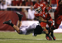 Scott Sommerdorf  |  The Salt Lake Tribune              Utah Utes running back Lucky Radley (44) is tackled during one of his two first half carries. Utah was tied with BYU 7-7 at the half, Saturday, September 15, 2012.