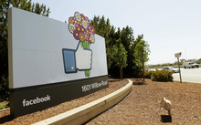 This May 11, 2012, photo shows a sign is shown at the Facebook campus in Menlo Park, Calif.  Silicon Valley, it turns out, doesn't revolve around the stock prices of Facebook and its playful sidekick, Zynga. Instead, the optimism in Silicon Valley can be seen in a variety of ways in this area that covers roughly 40 miles from San Jose to San Francisco (AP Photo/Jeff Chiu)