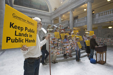 Paul Fraughton | Salt Lake Tribune A group of Utahns  concerned about Gov. Gary Herbert's support for  the Transfer of Public Lands Act and other  public land issues stand in the capitol rotunda  holding signs and voicing their opposition to the Governor's  policies.  With them they had a petition and postcards with more than 5400 signatures supporting their opposition.   Wednesday, September 12, 2012