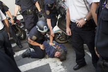 Anna Roblin is arrested during an Occupy Wall Street march, Monday, Sept. 17, 2012, in New York. A handful of Occupy Wall Street protestors were arrested during a march toward the New York Stock Exchange on the anniversary of the grass-roots movement. (AP Photo/John Minchillo)