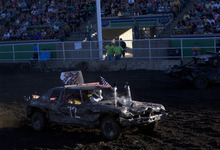 Kim Raff    The Salt Lake Tribune Dennis Sandoval, from the Sandoval Boyz team, competes during the Demolition Derby on the last day of the Utah State Fair in Salt Lake City on Sept. 16, 2012.
