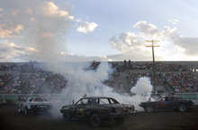 Kim Raff    The Salt Lake Tribune People compete in a heat during the Demolition Derby on the last day of the Utah State Fair in Salt Lake City on Sept. 16, 2012.