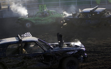 Kim Raff    The Salt Lake Tribune Drivers compete in a heat during the Demolition Derby on the last day of the Utah State Fair in Salt Lake City, Utah on September 16, 2012.