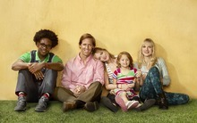 Dakota Johnson (center) and Nat Faxon (second from L) play odd couple siblings in the new Fox comedy