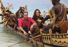 Britain's Prince William, center left, and his wife Kate, center right, the Duke and Duchess of Cambridge, arrive in Tavanipupu, Solomon Islands, on a traditional war canoe Monday, Sept. 17, 2012. (AP Photo/Rick Rycroft, Pool)