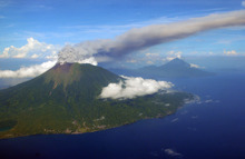 In this Sunday, Sept. 16, 2012 aerial shot, Mount Gamalama spews volcanic ash as it erupts on Ternate Island, eastern Indonesia. The volcano has erupted, spewing clouds of thick, gray ash. There were no immediate reports of injuries or damage. (AP Photo)