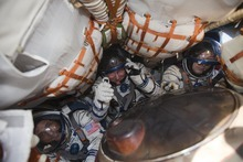 The International Space Station (ISS) crew members U.S. astronaut Joseph Acaba, left, Russian cosmonauts Gennady Padalka, center, and Sergei Revin sit inside the Soyuz TMA-04M capsule shortly after landing near the town of Arkalyk in northern Kazakhstan Sept. 17, 2012.  A Russian Soyuz capsule landed on the Kazakh steppe on Monday, delivering a trio of astronauts from a four-month stint on the International Space Station. (AP Photo/Shamil Zhumatov, pool)