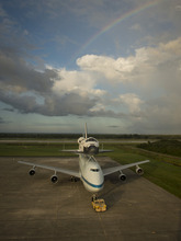 This photo provided by NASA shows space shuttle Endeavour atop NASA's Shuttle Carrier Aircraft, or SCA, at the Shuttle Landing Facility at NASA's Kennedy Space Center on Monday, Sept. 17, 2012 in Cape Canaveral, Fla. The beginning of Endeavour's final flight to California has been postponed because of weather along the flight route. NASA had planned for the 747 carrying the shuttle to take off from Kennedy Space Center on Monday. The flight is now scheduled to take off at sunrise Tuesday. (AP Photo/NASA, Bill Ingalls)