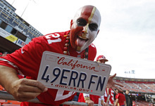 A San Francisco 49ers fan cheers before the start of their home-opener NFL football game against the Detroit Lions in San Francisco, Sunday, Sept. 16, 2012. (AP Photo/Tony Avelar)