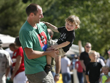 Scott Sommerdorf  |  The Salt Lake Tribune              Peter Archambault and his son Luc dance to