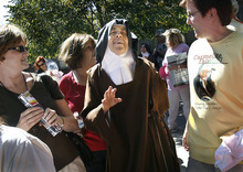 Scott Sommerdorf  l  The Salt Lake Tribune Mother Maureen of the Trinity walks through the crowd and greets visitors to the Carmelite Fair at the Carmelite Monastery in Holladay, Sunday, Sept. 19, 2010.