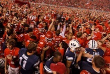 Trent Nelson  |  The Salt Lake Tribune Utah fans swarm the field as Utah defeats BYU college football in Salt Lake City, Utah, Saturday, September 15, 2012.