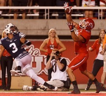 Trent Nelson  |  The Salt Lake Tribune Utah tight end Westlee Tonga (80) pulls in a touchdown pass in the first quarter, with Brigham Young's Kyle Van Noy (3) defending during the game in Salt Lake City on Saturday, Sept. 15, 2012.