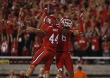 Scott Sommerdorf  |  The Salt Lake Tribune              Utah Utes wide receiver Dres Anderson (6) and Utah Utes running back Lucky Radley (44) celebrate Anderson's TD catch against BYU on Saturday, Sept. 15, 2012.