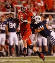 Trent Nelson  |  The Salt Lake Tribune Utah quarterback Jon Hays fumbles the ball out of bounds under pressure from Brigham Young linebacker Kyle Van Noy during the game in Salt Lake City on Saturday, Sept. 15, 2012.