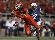 Scott Sommerdorf  |  The Salt Lake Tribune              Utes wide receiver Dres Anderson missed controlling this long pass from QB Jon Hays during first-half play against BYU on Saturday, Sept. 15, 2012. Defending for BYU is DB Preston Hadley (7).