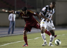U.S. Real Salt Lake Javier Morales, left, and Panama's Tauro FC Jean Alberto McLean fight for the ball during a CONCACAF Champions League soccer match in Panama City, Tuesday, Sept. 18, 2012. (AP Photo/Arnulfo Franco)