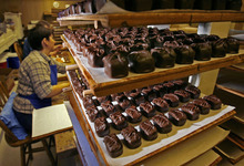 Tribune file photo Chocolates are still dipped by hand at the Bluebird Candy Company in Logan.