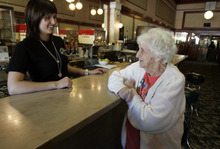 Tribune file photo Server Tracy Hatfield of Perry, left, visits with Edna Romer of Brigham City at the Idle Isle in this 2009 file photo. Romer worked at the cafe when she was 17 years old.