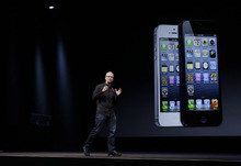 Apple CEO Tim Cook during an introduction of the new iPhone 5 in San Francisco, Wednesday, Sept. 12, 2012.  (AP Photo/Eric Risberg)