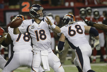 Denver Broncos quarterback Peyton Manning (18) works against the Atlanta Falcons during the first half of an NFL football game, Monday, Sept. 17, 2012, in Atlanta. (AP Photo/John Bazemore)
